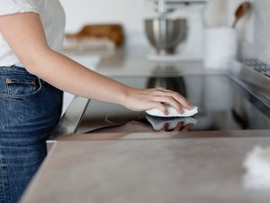 Woman cleaning stovetop