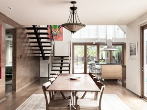 Dramatic lines of wood and metal in the dining room and kitchen area.