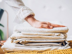 Stack of folded bed sheets