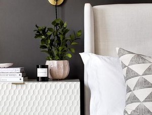 black guest bedroom idea with white headboard and white nightstand