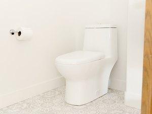 One-piece white toilet