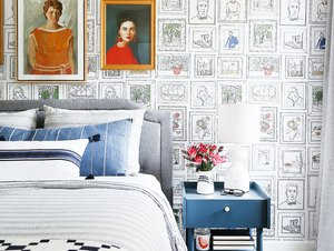 guest bedroom decorating idea with quirky wallpaper and vintage artwork
