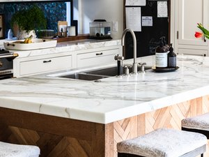 kitchen marble countertop on kitchen island with sink with high-arc faucet