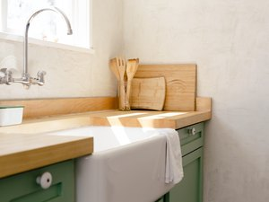 wall-mount faucet, farmhouse sink and butcher block kitchen countertop