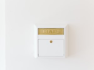 gold and white mail box