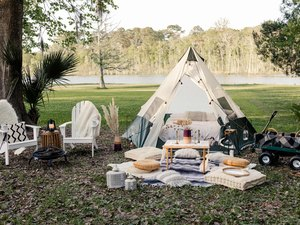 DIY backyard glamping tent with fire pit and lounge area