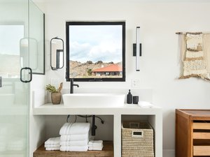 bathroom vanity and sink, and storage options