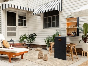 Patio with folded down Murphy bar mounted to wall