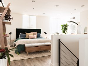 Hunker House bedroom with upholstered headboard and bed bench