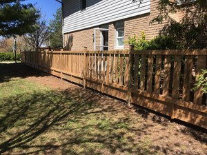 Wooden fence next to house.
