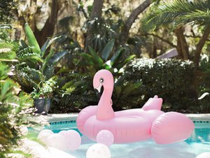 pink flamingo pool float in pool