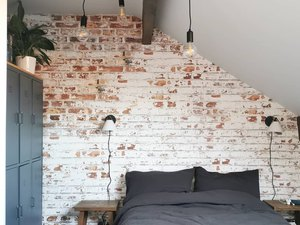 whitewashed brick wall industrial wallpaper in a bedroom