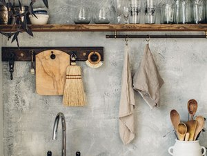 concrete effect kitchen backsplash with wood countertop and open shelving