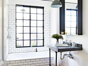 industrial bathroom with subway wall tile and pedestal sink