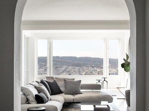 arched doorway leading to neutral living room with view of san francisco