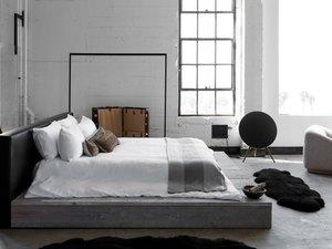gray industrial bedroom with platform bed