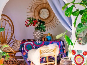bohemian outdoor space with chairs and sun-shaped mirror
