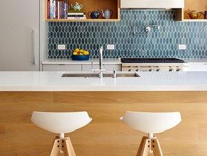 midcentury modern kitchen backsplash idea with blue tile and white cabinets
