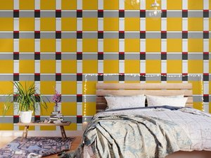 red yellow and blue Bauhaus wallpaper in bedroom