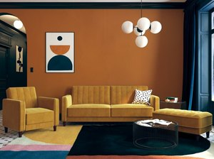 bauhaus colors in living room with yellow couches and orange walls
