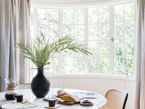 dining room curtain idea with bow window and red pendant light over table
