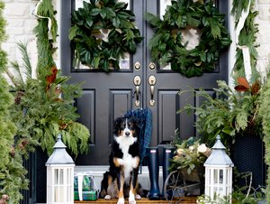 DIY Outdoor Christmas Decorations with garland and black door