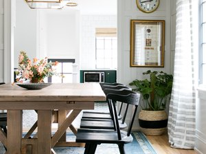 dining room rug idea with darker pattern in navy blue beneath rustic wood table