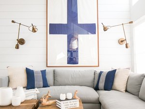 white living room with sectional sofa and shiplap walls