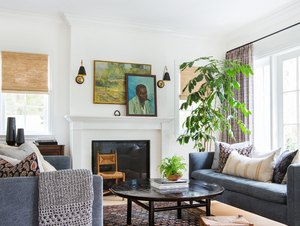 living room lighting idea with pair of brass and black traditional sconces