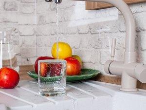 Healthy lifestyle, apples in white interior kitchen