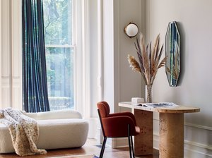 modern home office with a red chair and blue curtains