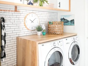 Budget-Friendly Small Laundry Room Ideas in boho laundry room with DIY stacked plywood countertop