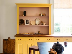 yellow kitchen with Raised Panel Cabinetry