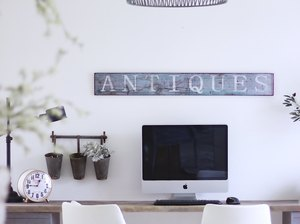 Farmhouse home office with vintage sign and black woven chandelier