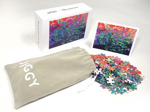 drawstring bag with colorful puzzle piezes and box