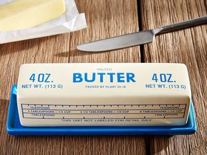 west elm blue butter dish with stick of butter and silver knife