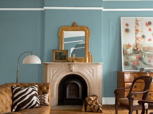 Benjamin Moore's color of the year Aegean Teal in living room with fireplace