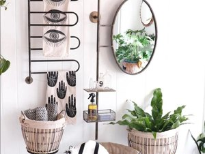 Modern bathroom with towel rack for small bathroom, mirror, and plant