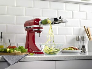 red stand mixer on kitchen counter