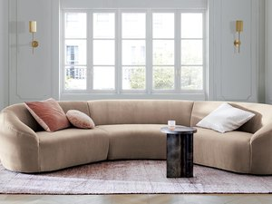 living room with white walls and large sectional sofa in beige color
