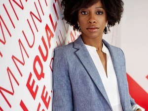 photograph of Kia Weatherspoon against white and red wall with text