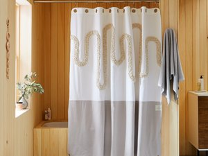 graphic shower curtain near wood tub and shower