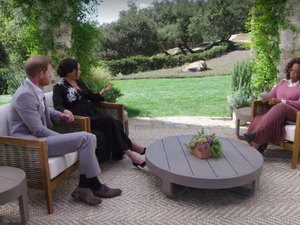 harry and meghan sitting outdoor with oprah