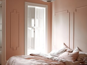 contemporary colors in peach bedroom with circle pendant