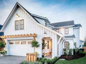 Farmhouse garage door in white with wood pergola