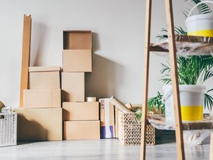 Carton boxes in an empty room. Moving to a new home. Belongings in cardboard boxes. Concept relocation.
