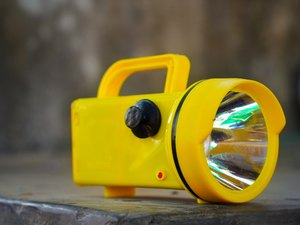 Electronic Super Bright LED Flashlight with yellow color for Emergency Traffic or Parking Arrangement Tools.