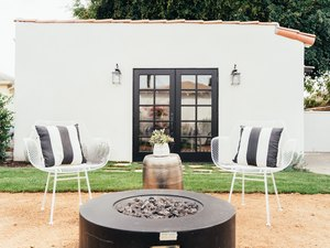 Back guest house with black outdoor fire pit
