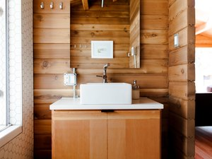 White sink on wood cabinet in bathroom