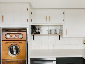 White kitchen with midcentury copper oven